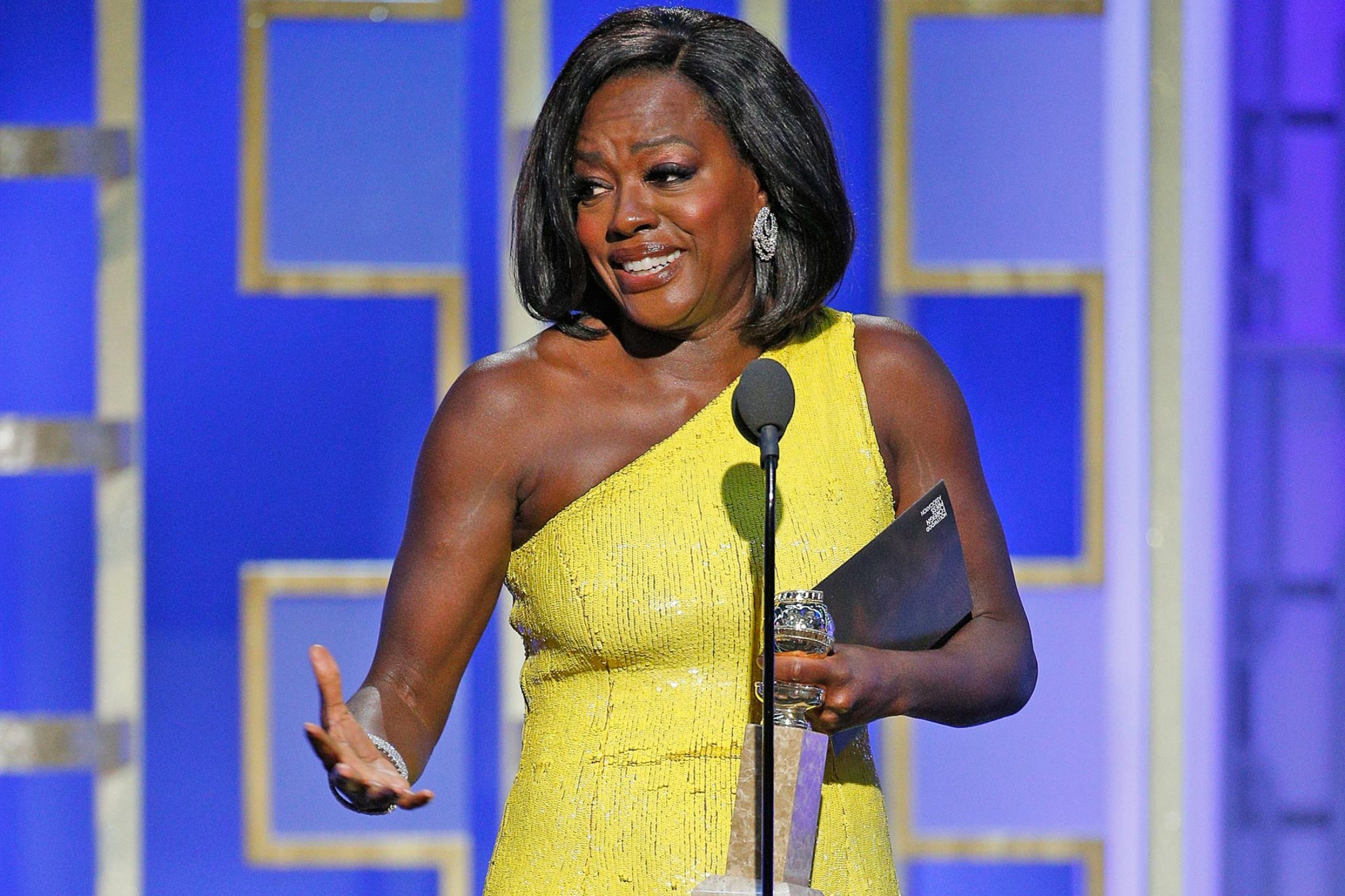 "This image released by NBC shows Viola Davis with the award for best supporting actress in a motion picture for ""Fences,"" at the 74th Annual Golden Globe Awards at the Beverly Hilton Hotel in Beverly Hills, Calif., on Sunday, Jan. 8, 2017. (Paul Drinkwater/NBC via AP)"